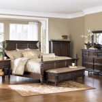 bed benche pillows table cabinet rug mirror