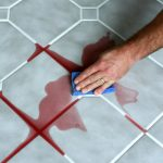 best way to clean tile grout applying solution cleaner scrubbing with vlue sponge