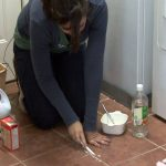 best way to clean tile grout with homemade vinegar baking soda cleaner applying the paste with toothbrush