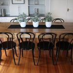 black bentwood most comfortable dining chair wooden dining table wooden floor white wall decorative flowers