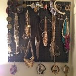 black pegboard jewelry display natural color jewelries sunglasses