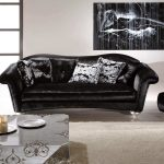 black sofa pillows table rug