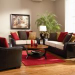 black sofas pillows table lamp rug