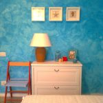blue faux painting frames decor wood cabinet small lamp simple chair