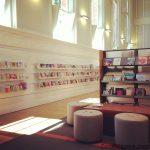 bookshelf library books chair