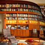 bookshelf library books chair table