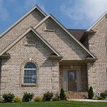 brick siding for home invory white brick siding house green yard house