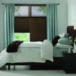 Brown Cellular Blackout Blinds With Soft Blue Drapery For Bedroom Soft Blue Carpet Brown Wooden Furniture Soft Blue Brick Wall White Blue Cushions And Bedsheet