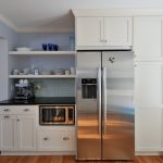 Built In Cabinets For Kitchen Area A Big Refrigerator Wood Floors Window Glass With White Blinds Dishware Collections White Kitchen Countertop
