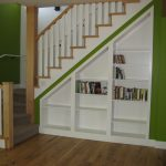 Built In Storage Under The Stairs Wooden Handrail And White Vertical Wood Railing System Wood Floor Idea