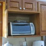 built in toaster oven in wooden cabinet white wall kitchen white kitchen hardware