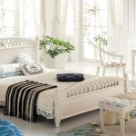 cabinet rug benche bed pillows lamp curtains