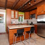 ceiling beams refrigerator wood set kitchen chairs