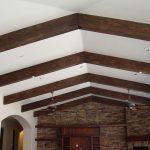 ceiling beams wall stone lamp
