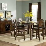 centerpieces for dining room tables with yellow flowers on glass vase and wooden table and seating plus beige rug underneath plus traditional wooden sideboard