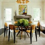 centerpieces for dining room tableswith fresh flower on round table with glass top and traditional dining chair plus rug and fireplace with picture on wall decoration