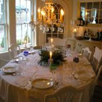 chandelier chairs table cloth plates glass