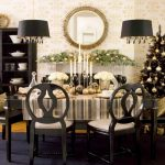 christmast centerpieces for dining room tables with candle of glass candleholder and flower bucket on wooden table with striped table cloth and wood chairs