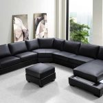 classic bold black huge sectional sofa white porcelaine floor abstract paintings simple black bookshelves