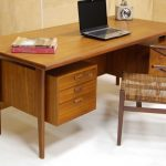 classic designed mid century secretary desk design in furnished style with classic vintage chair with drawers in beige office idea