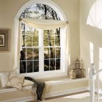 classic white hanging curtain for white casement windows beige walls living room with beige rug and cushions