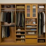 classic wooden closet organizer for small closet idea in beige color with storage glass and drawers and shoes racks and stainless steel hanger