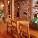 clean red pine flooring house decorative green living plant wooden house furniture stone walls