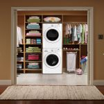 closet dryer washer clothes desk hanger rug wood floor pictures