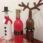 colorful christmas wine bottle decorating ideas in brown red and white shaping deer snowman and santa claus on wooden table with floral red table cloth