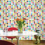 colorful pola dot patterned peel and stick removable wallpaper idea in rainbow color with red chair white table and potted plant and unique side table