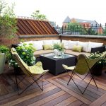 comfortable balcony setting with walmart patio relaxing chairs and creamy banquette and wooden deck and potted plants