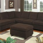 comfy brown 2 piece sectional sofa with chaise featuring brown ottoman plus white and grey rug on wooden laminate floor