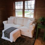 couch pillows windows wood table rug plant basket