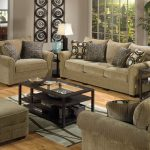 couches pillows table rug floor wall windows