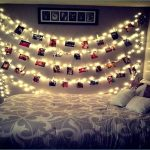 creative diy string light bedroom application in bedroom with photos accent above headboard on patterned sheet