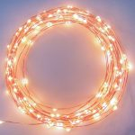 creative diy string light ring design for wall decoration in a bedroom