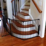 curved style of baby gate for top stairs design for wooden concrete staircase on wooden floor beneath white wall