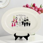 cute and simple wedding gifts of white oval plate with cute picture of bride groom and the families for home centerpiece