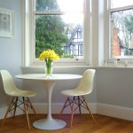 cute ivory small oval dining table with white stools beautiful decorative yellow flower wooden floor