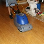 deep cleaning hardwood floors by using modern vacuum cleaner machines