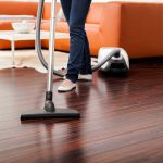 deep cleaning hardwood floors by using a vacuum cleaner