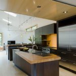 delighful kitchen ideas with engineered hardwood flooring pros and cons decorated with sophisticated wooden kitchen cabinets and track lighting fixture
