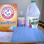 easy homemade vinegar baking soda cleanser spray to get rid of pet odor blue and white towels