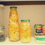 easy natural homemade citrus enzyme cleanser to get rid of pet odor citrus peels in jars food cabinet