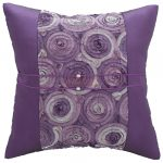 elegant and modern purple accent pillow design with smooth silky material and textured patterned fabric