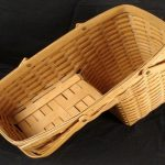 elegant beige bamboo basket for stairs design with handles on black flooring idea
