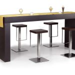 elegant brown wooden long bar table for home design with brown rectangle stool with stainless steel accent and yellow centerpiece