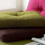 elegant floor pillows ikea design in pink green and brown color with single tuft pattern on green textured area rug with papers and a cup