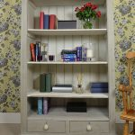 elegant gray shabby chic bookshelves idea with dull white inner color with wooden chair and floral patterned wallpaper