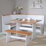elegant white corner breakfast nook furniture with beige accent and banquette and bench and flower vas and wall racks